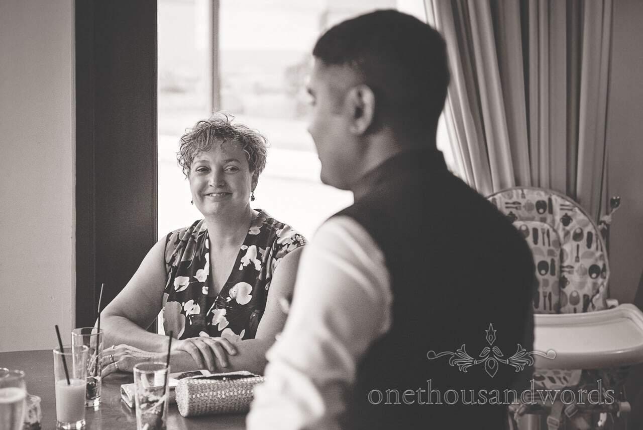 Black and white wedding portrait of wedding guest at Dorset wedding