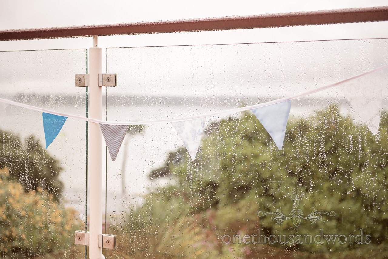 Blue wedding bunting in the rain at Harbour Heights Hotel Wedding