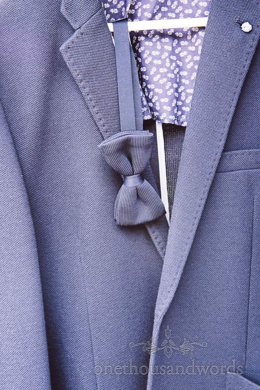 Blue wedding suit and blue wedding bow tie detail photograph