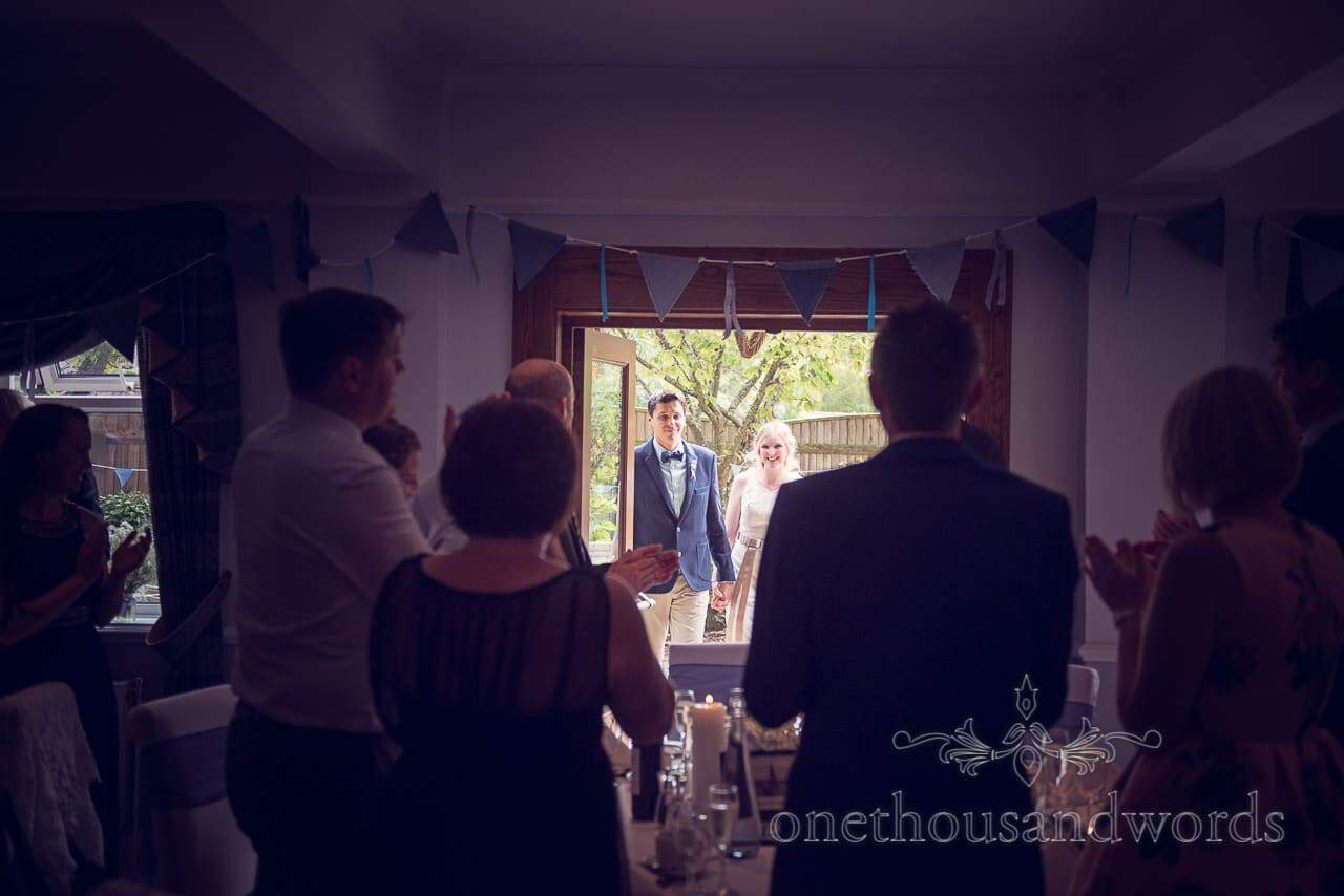 Bride and groom are welcomed into Balmer Lawn Hotel Wedding breakfast