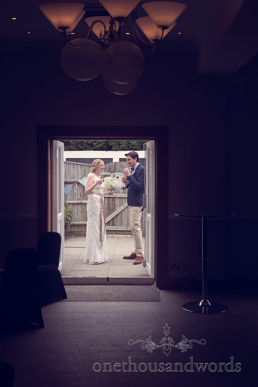 Bride and groom enjoy a drink alone at Balmer Lawn Hotel Wedding