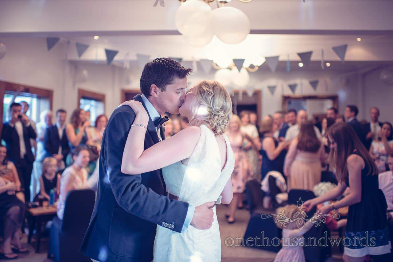 Bride and groom kiss after first dance at Balmer Lawn Hotel Wedding