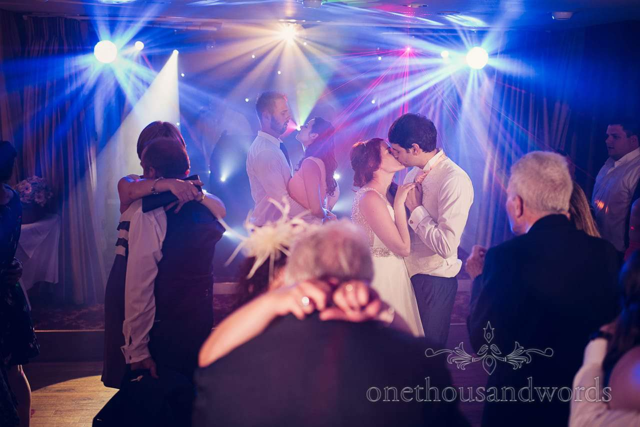 Bride and groom kiss on dance floor Bournemouth Hotel Wedding