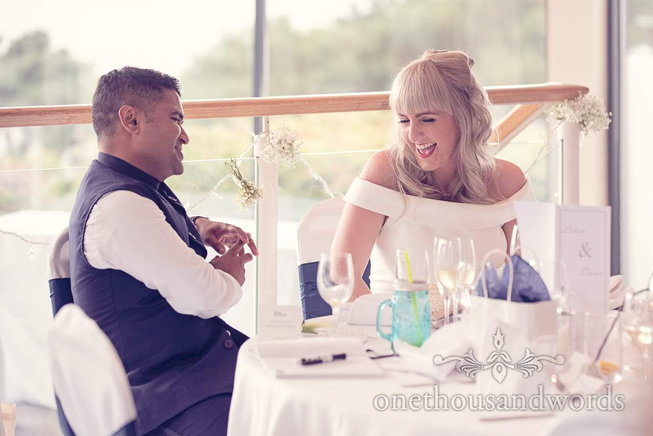 Bride and groom laugh at Harbour Heights Hotel Wedding speeches