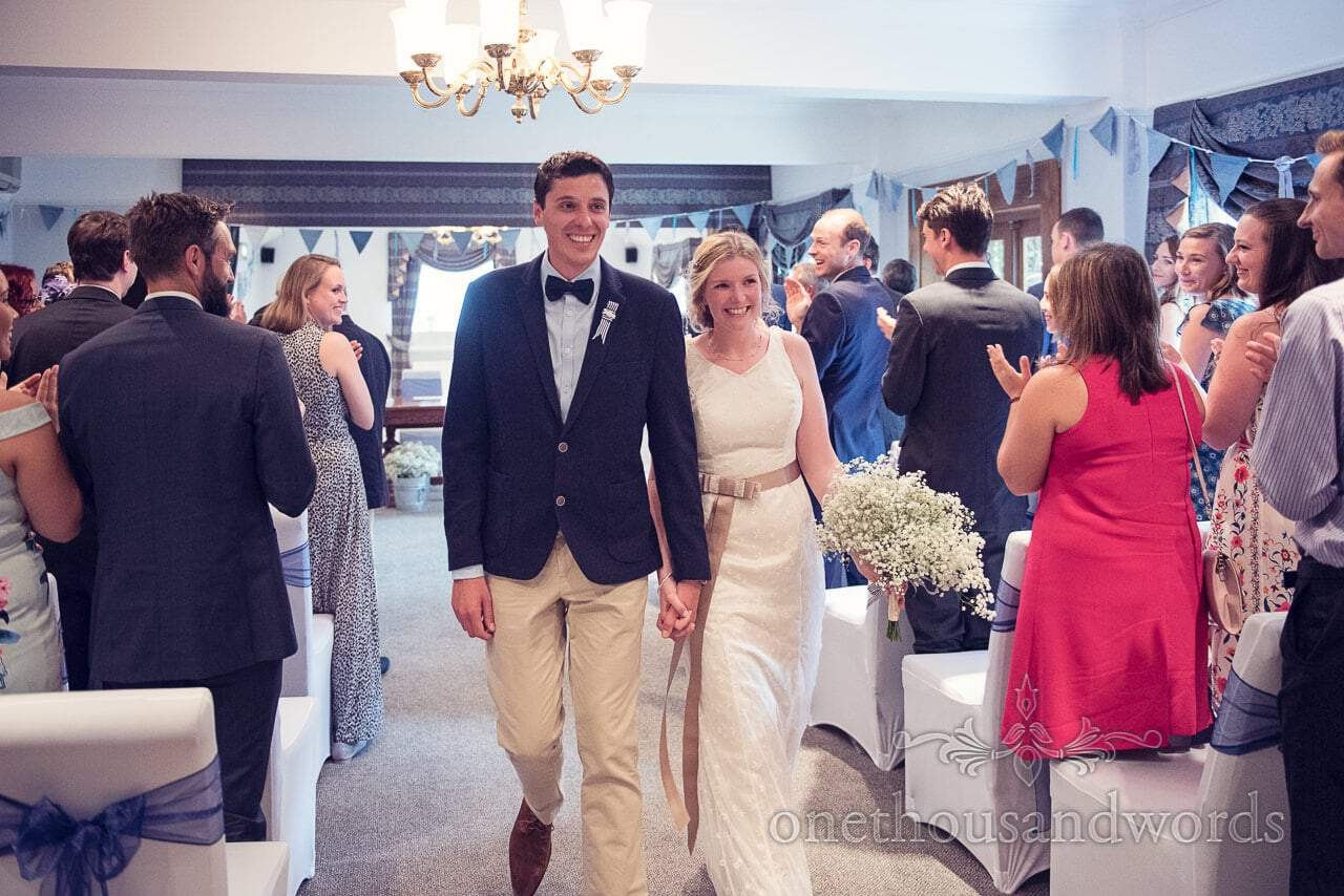 Bride and groom walk down the aisle at Balmer Lawn Hotel Wedding ceremony