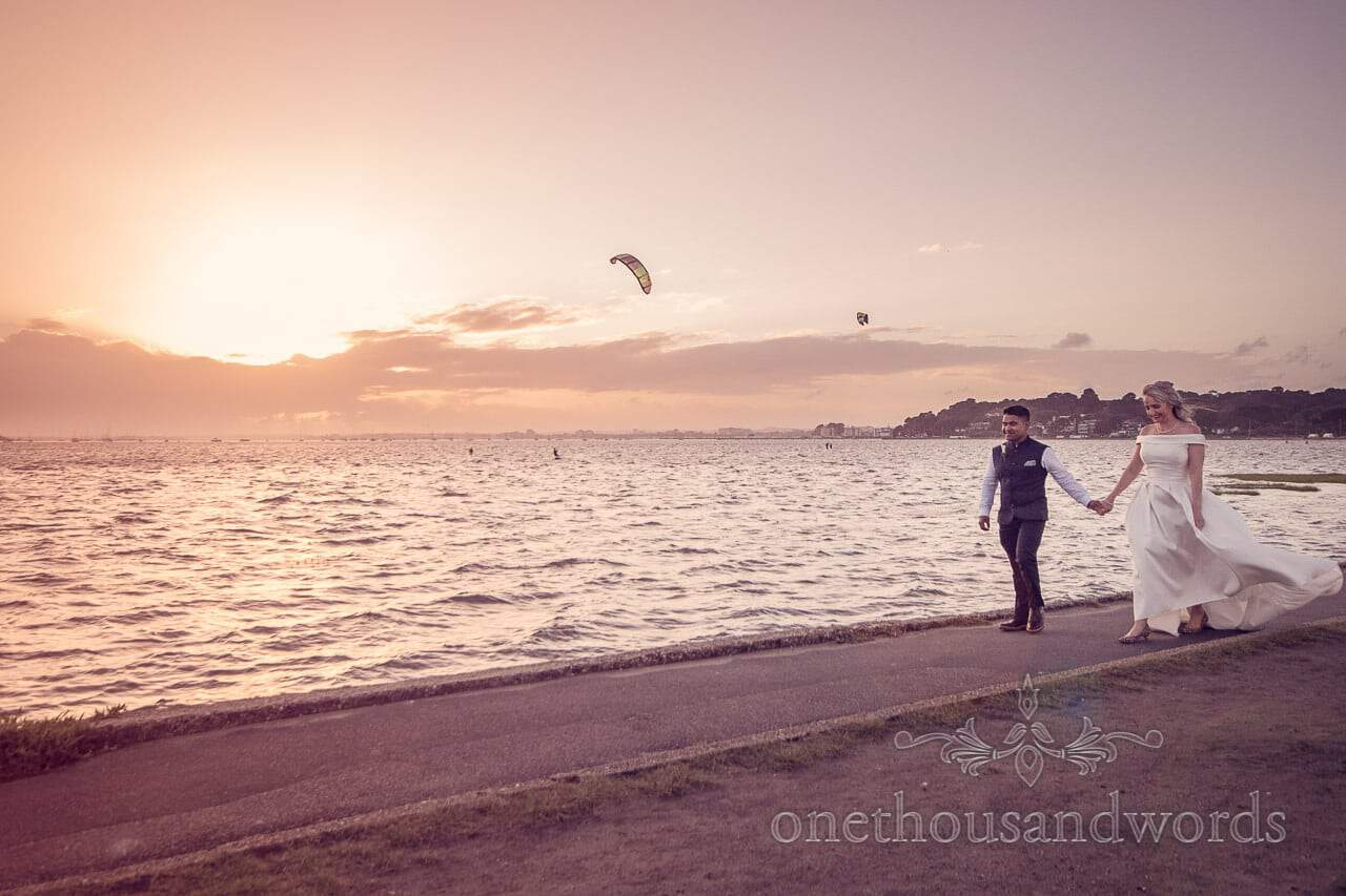Bride and groom with sunset over Poole Harbour