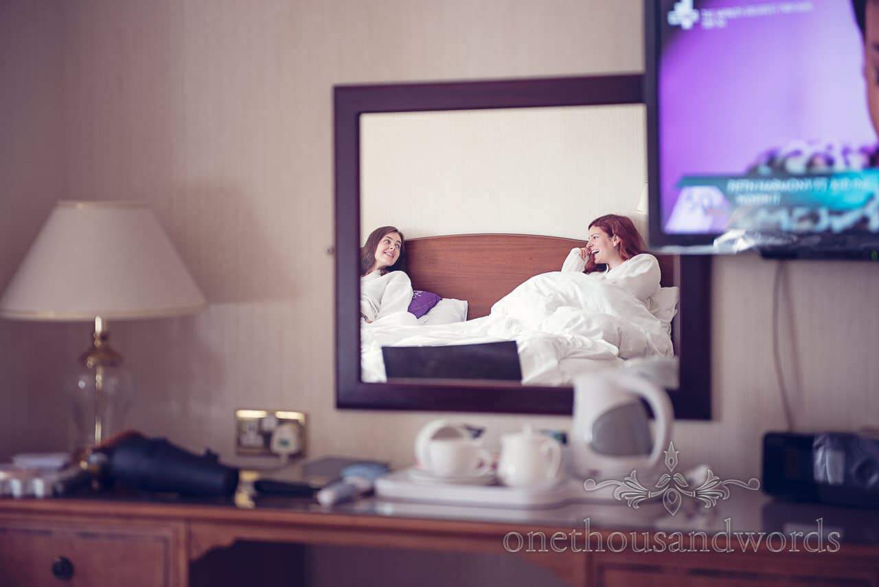 Bride and Matron of honor in mirror from Bournemouth Hotel Wedding