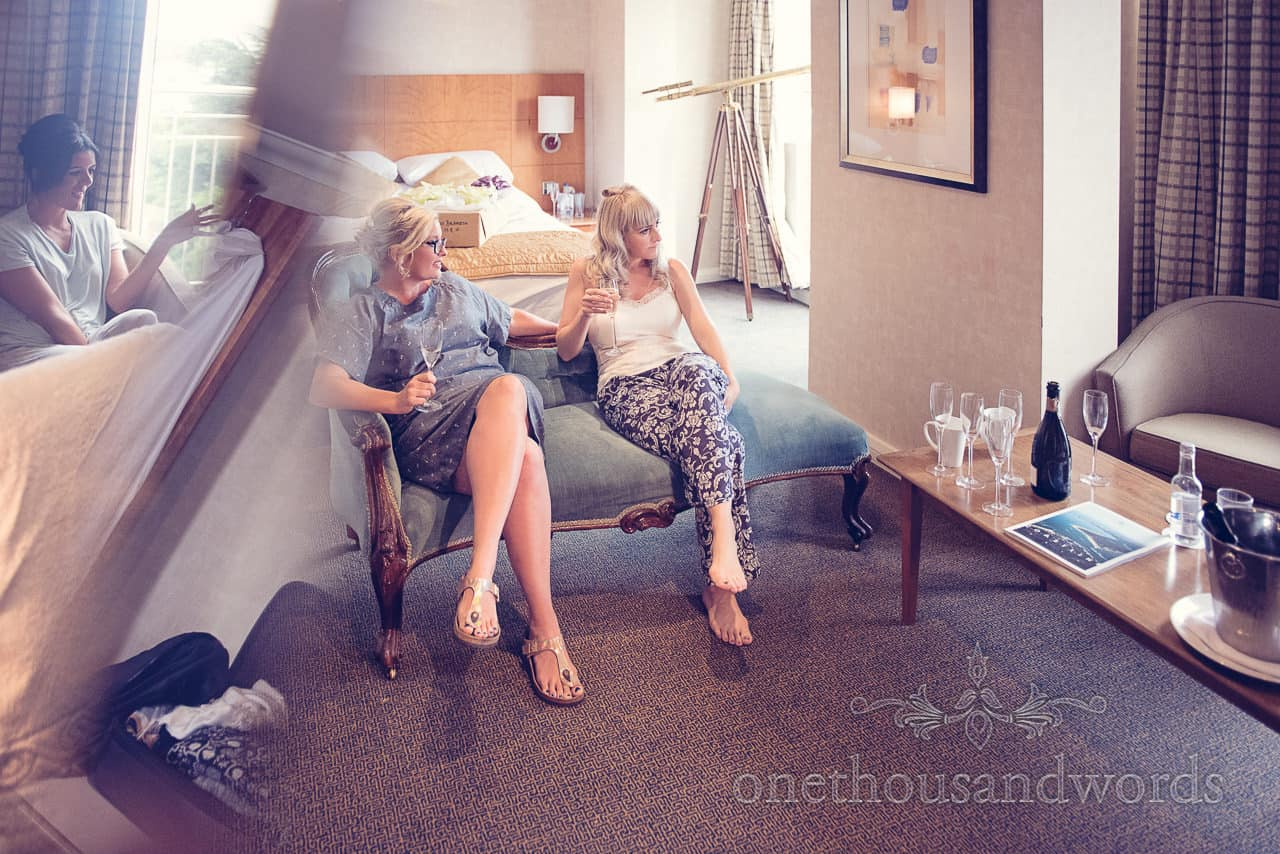 Bride drinks champagne in bridal suite at Harbour Heights Hotel Wedding venue