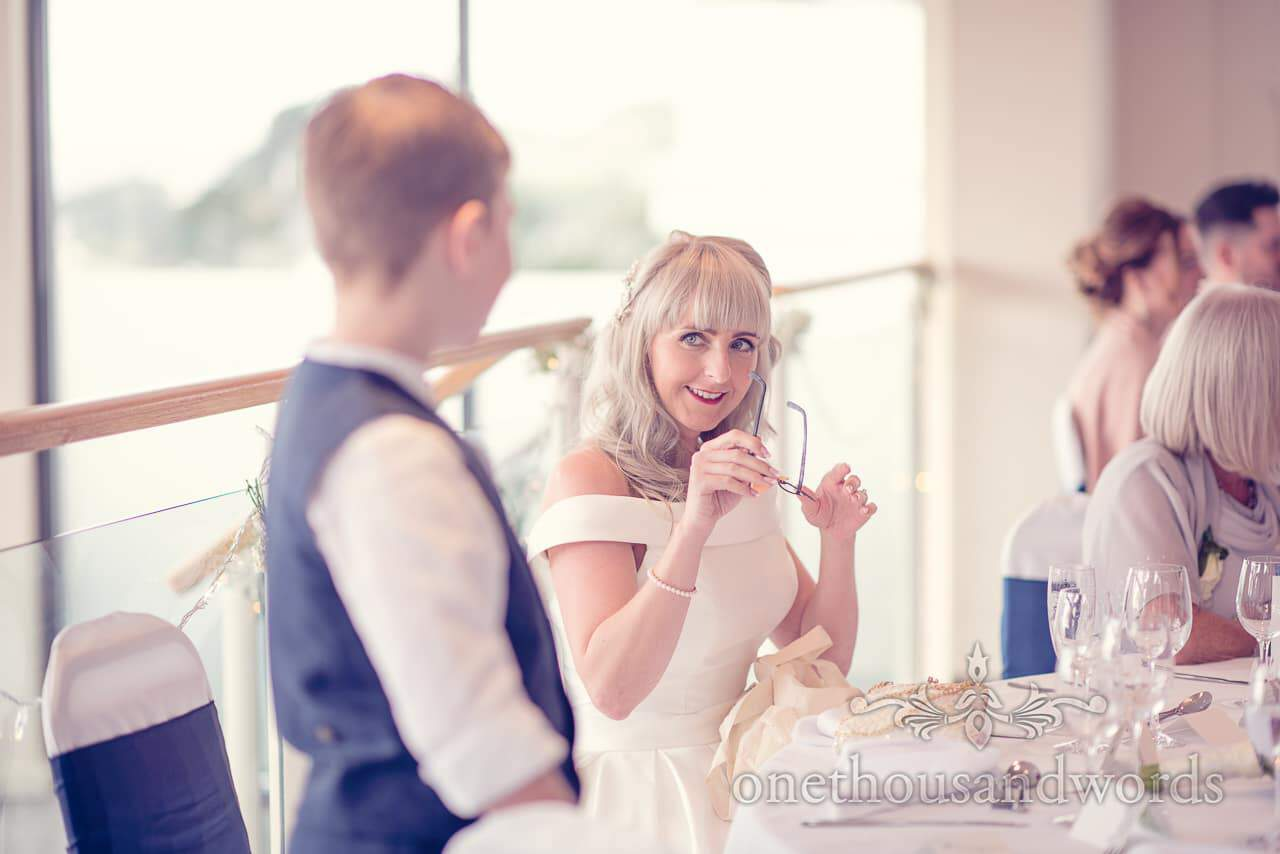 Bride gives joke glasses gift to page boy at Harbour Heights Hotel wedding