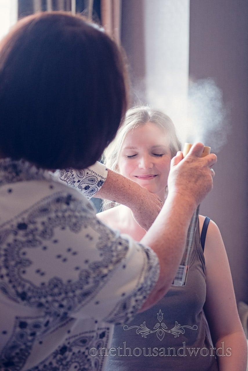 Bride has hair sprayed during Balmer Lawn Hotel Wedding preparations