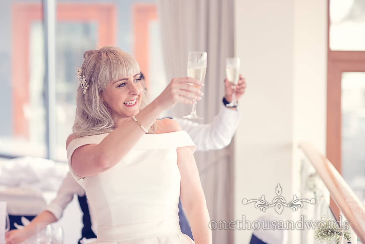 Bride raises a toast to Brownsea Island during Harbour Heights Hotel Wedding speeches