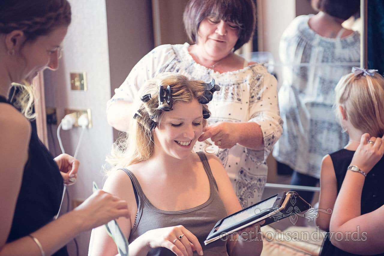 Bride smiles with hair in curlers on Balmer Lawn Hotel Wedding morning
