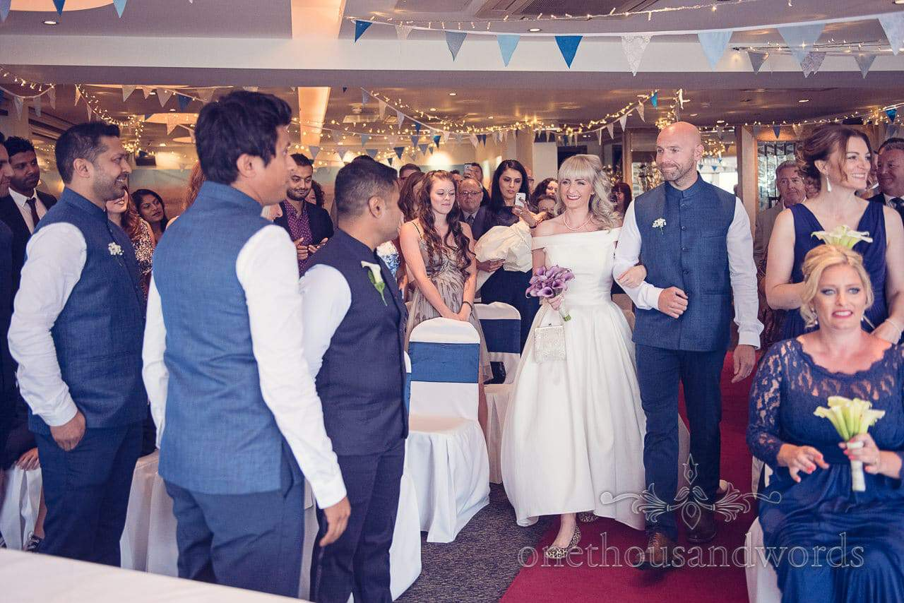 Bride walks down the aisle at Harbour Heights Hotel Wedding ceremony