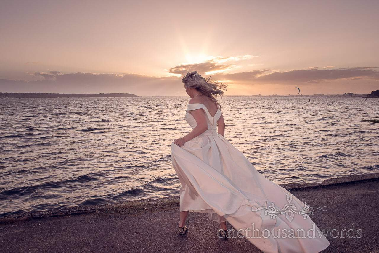 Bride with sunset over sea at Harbour Heights Hotel Wedding