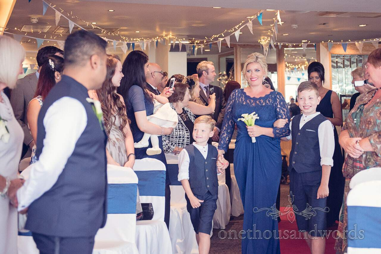 Bridesmaid and page boys walk down the aisle at Harbour Heights Hotel Wedding