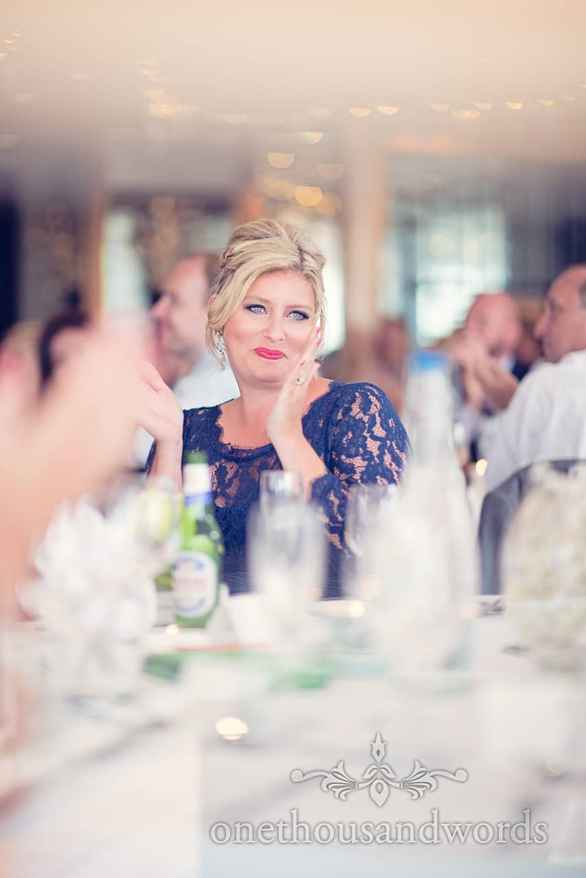 Bridesmaid claps during wedding speeches at Harbour Heights Hotel Wedding venue