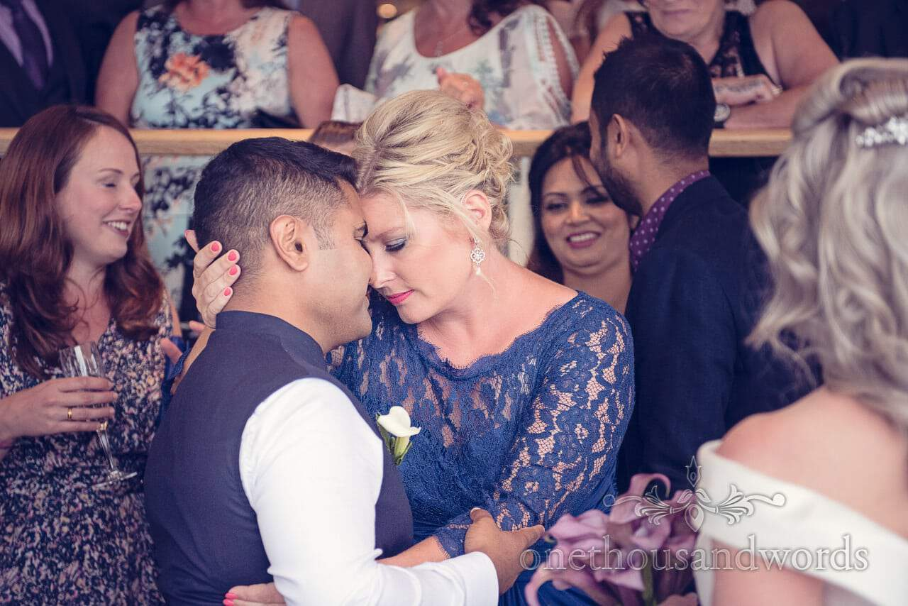 Bridesmaid hugs groom at Harbour Heights Hotel Wedding group photographs