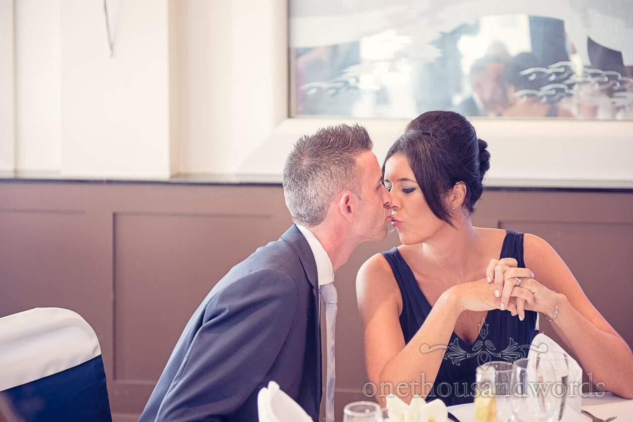Bridesmaid kisses husband at Harbour Heights Hotel Wedding