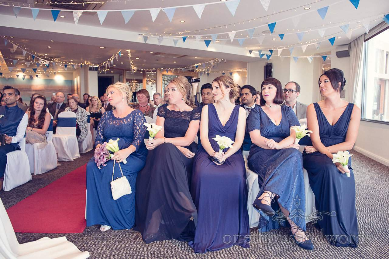 Bridesmaids in blue bridesmaids dresses at Harbour Heights Hotel Wedding ceremony