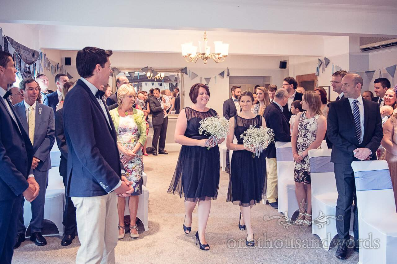 Bridesmaids in Navy blue dresses at Balmer Lawn Hotel Wedding ceremony