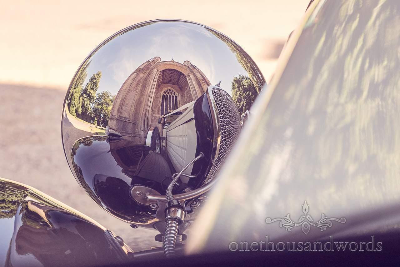 Classic wedding car headlight chrome fish eye view of Highcliffe Castle wedding venue