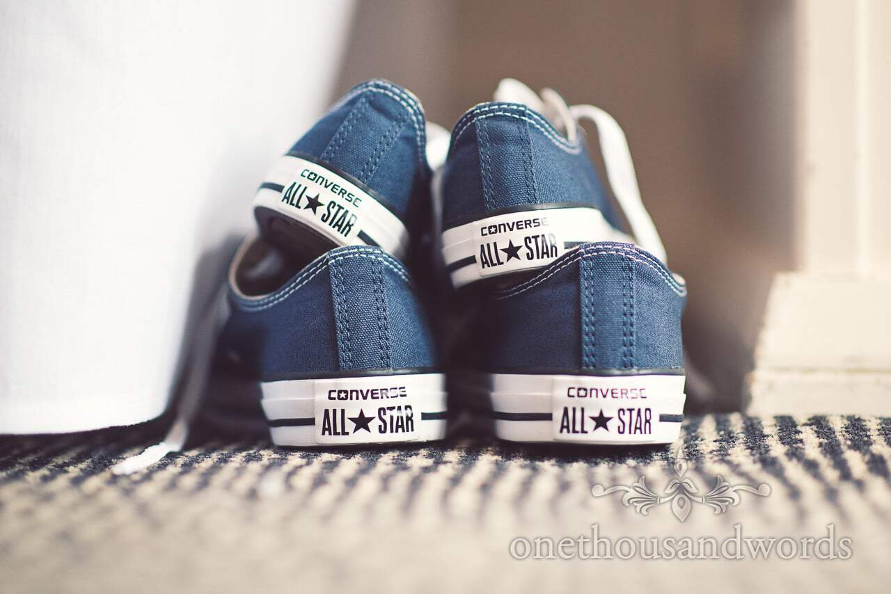 Converse All Star wedding shoes in blue at wedding in Dorset
