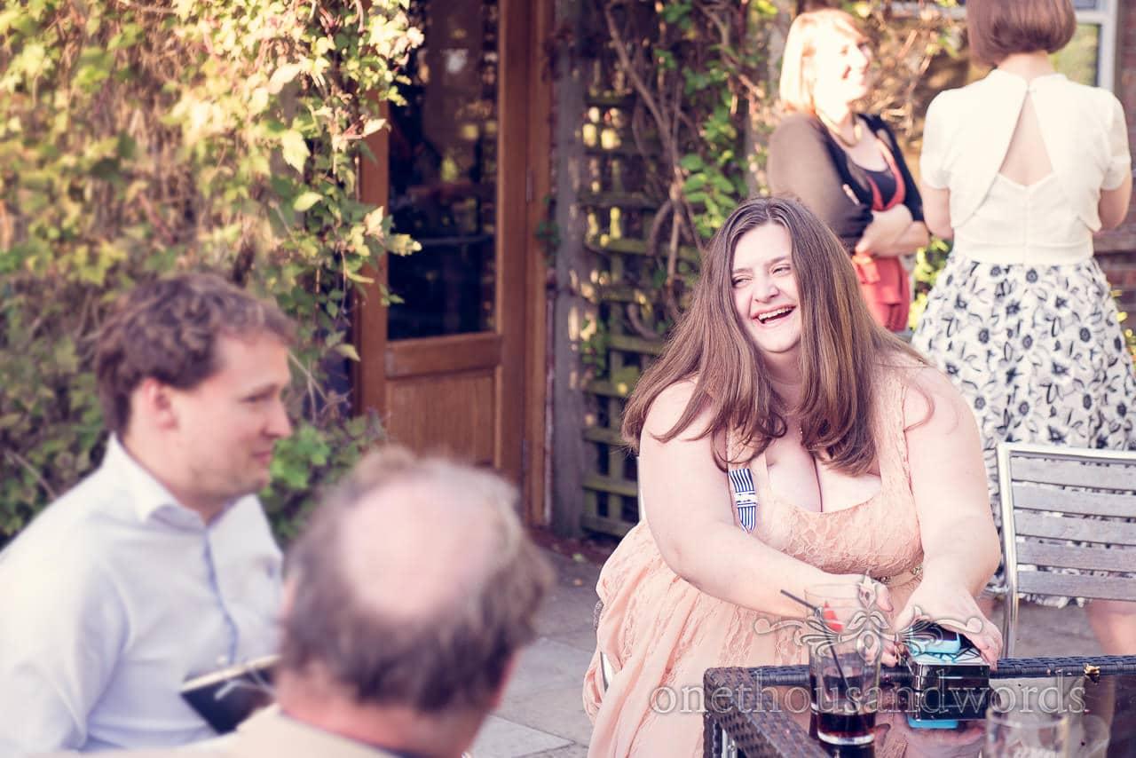 Female usher enjoying drinks reception at Balmer Lawn Hotel Wedding