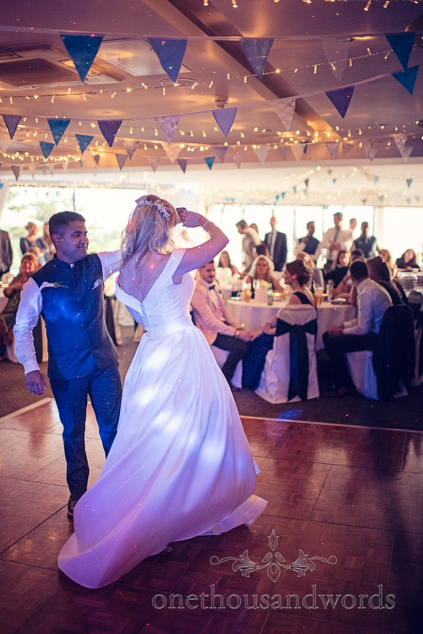 First dance spin under bunting at Harbour Heights Hotel Wedding