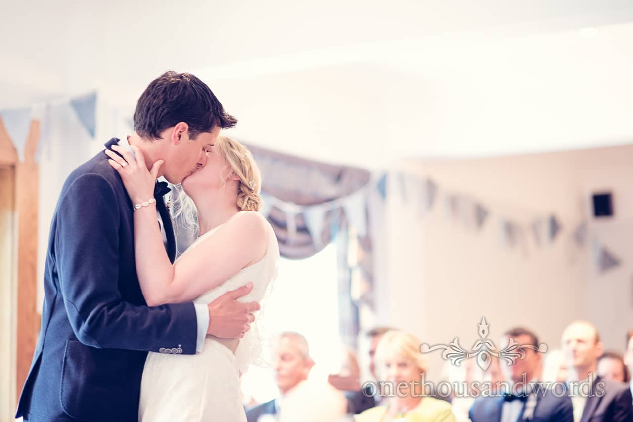 First kiss at Balmer Lawn Hotel Wedding ceremony in The New Forest
