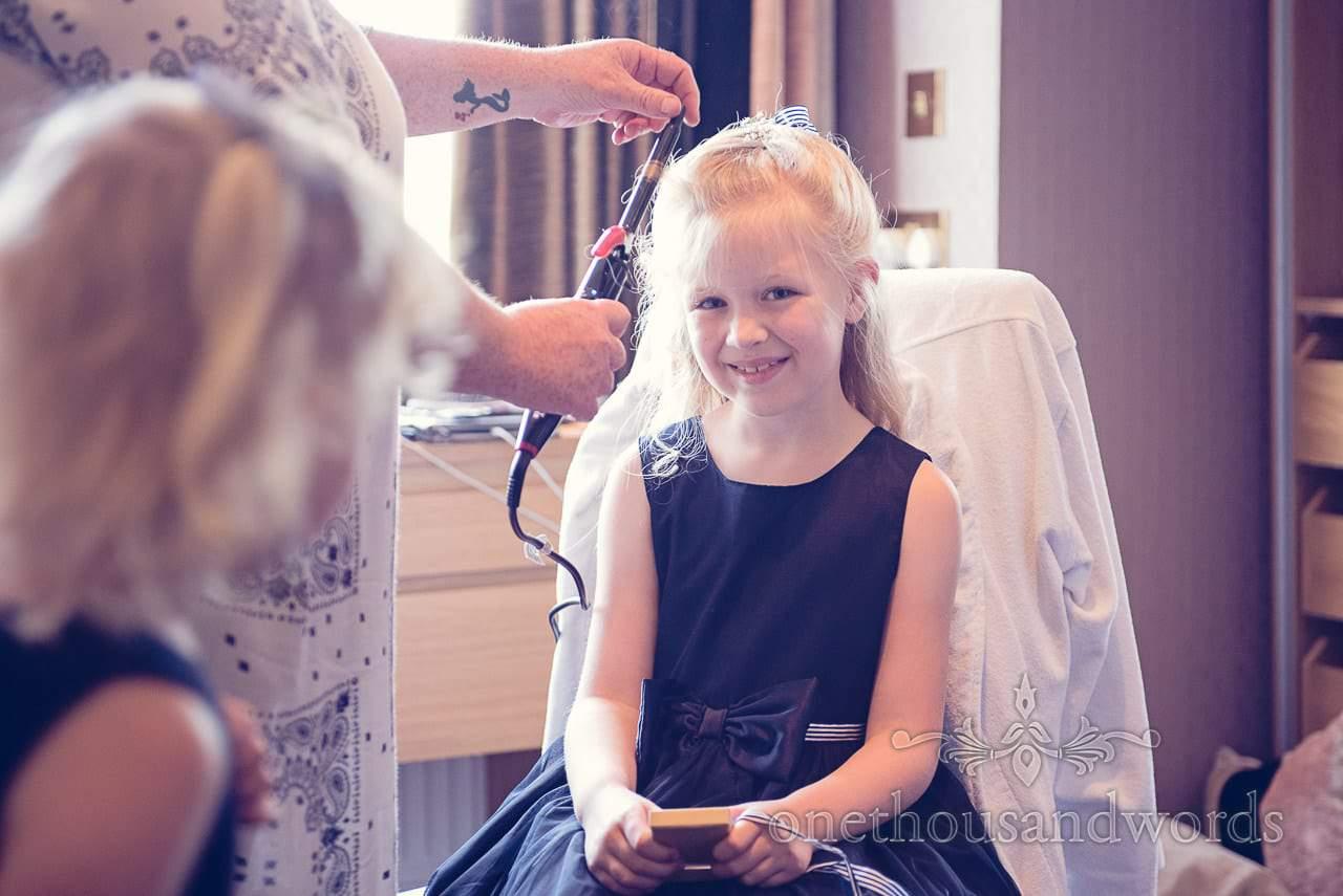 Flower girl has hair styled for Balmer Lawn Hotel Wedding