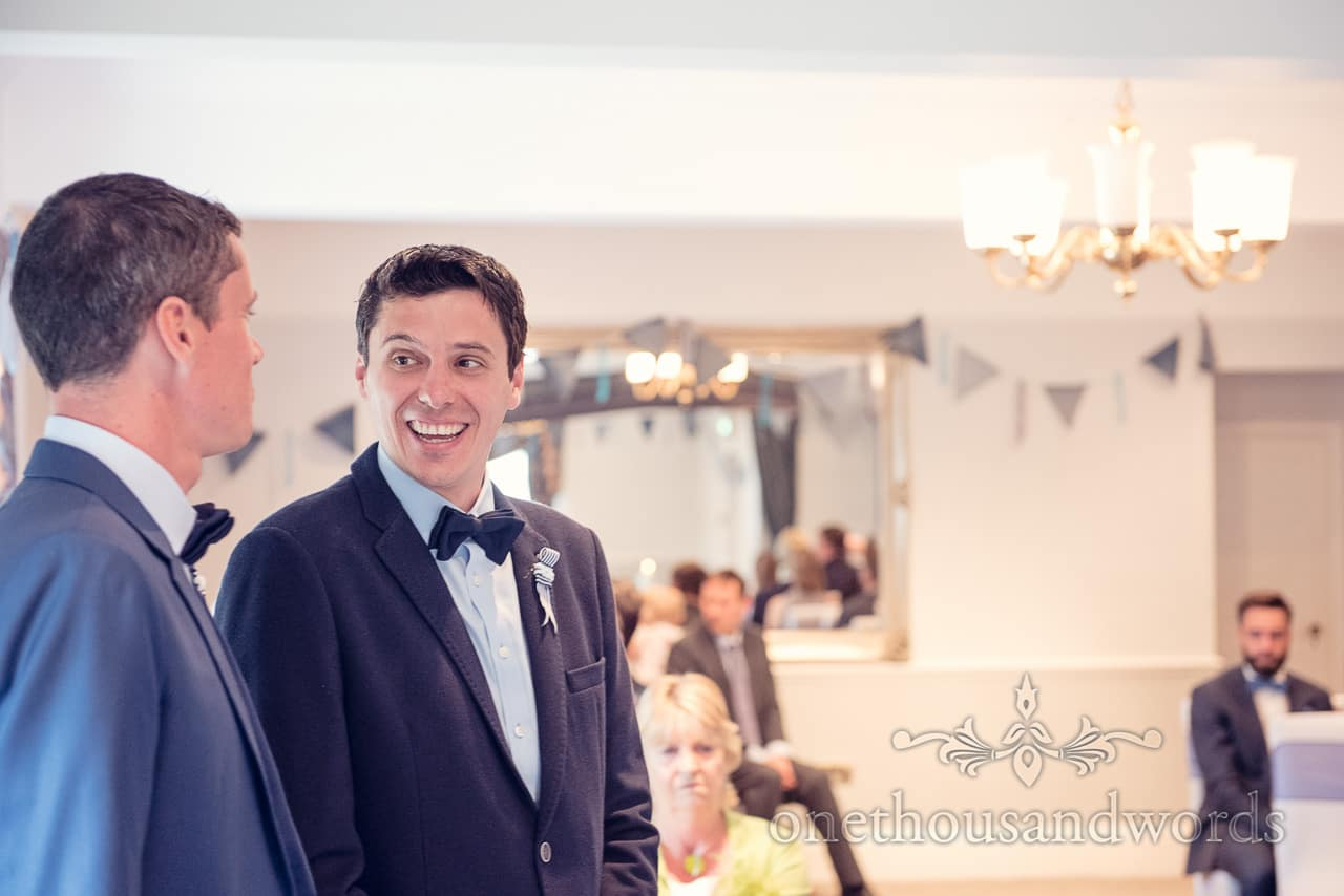 Groom and best man laughing before Balmer Lawn Hotel Wedding ceremony