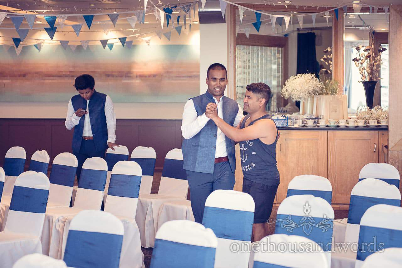 Groom dances withbest man in Hytes Suite at Harbour Heights Hotel Wedding