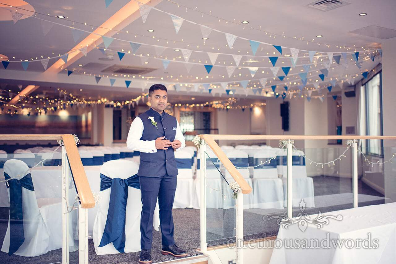 Groom in blue sleeveless wedding suit at blue themed Harbour Heights Hotel Wedding