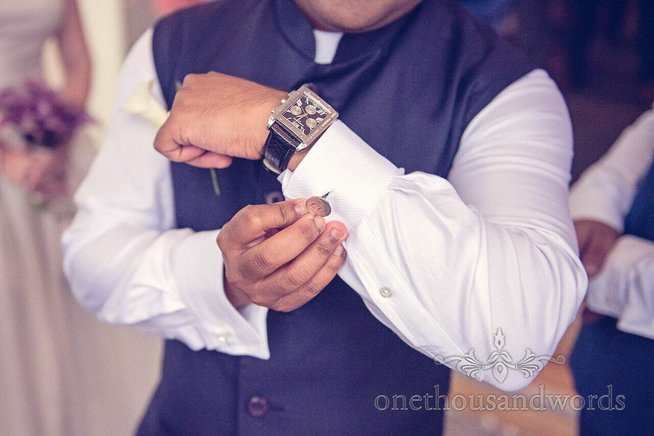 Groom with monogrammed wedding cufflinks at Harbour Hotel Heights Wedding