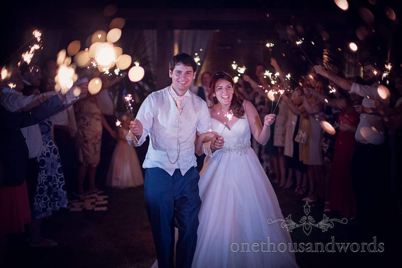 Guests and newlyweds with sparklers in garden at Bournemouth Hotel Wedding