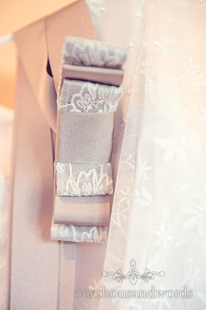 Hand made Wedding dress lace and ribbon detail photograph
