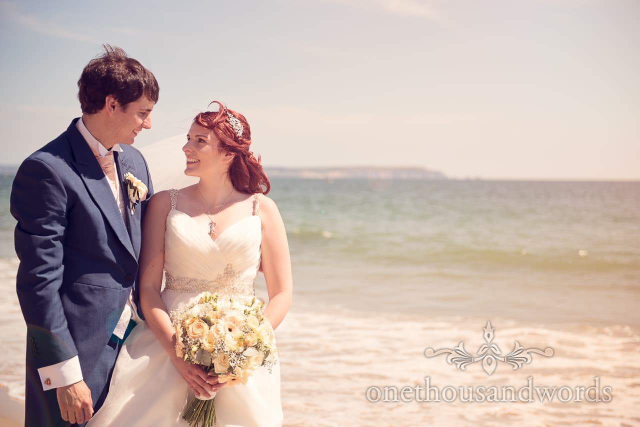 Newlyweds on the beach during Bournemouth Hotel Wedding