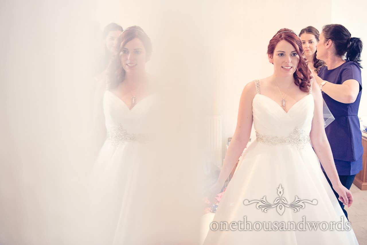 Red Head Bride has veil attached at Bournemouth Hotel from our best wedding photos