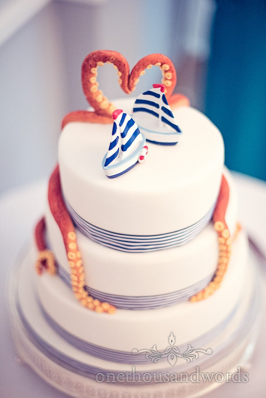 Sailing boats with octopus on nautical themed wedding cake