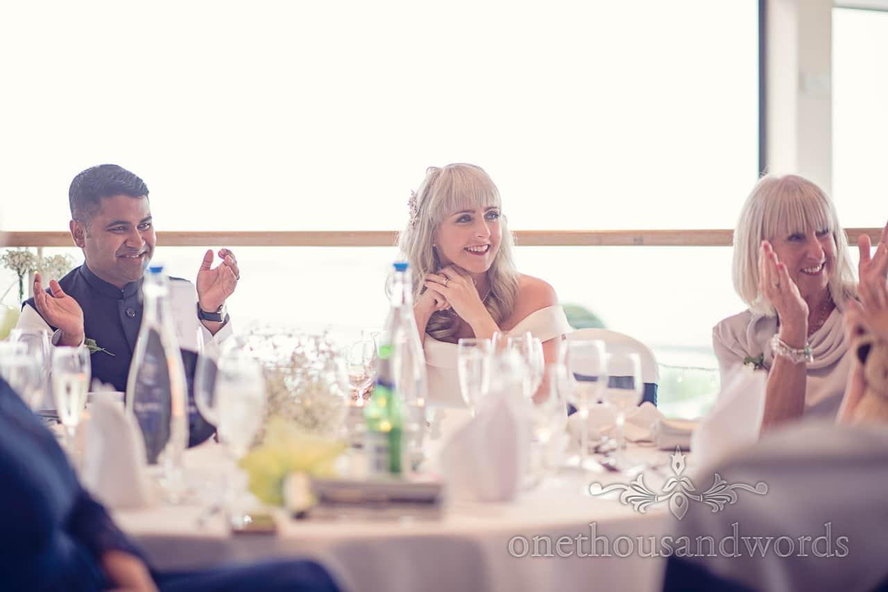 Top table applauds wedding speeches at Harbour Heights Hotel Wedding