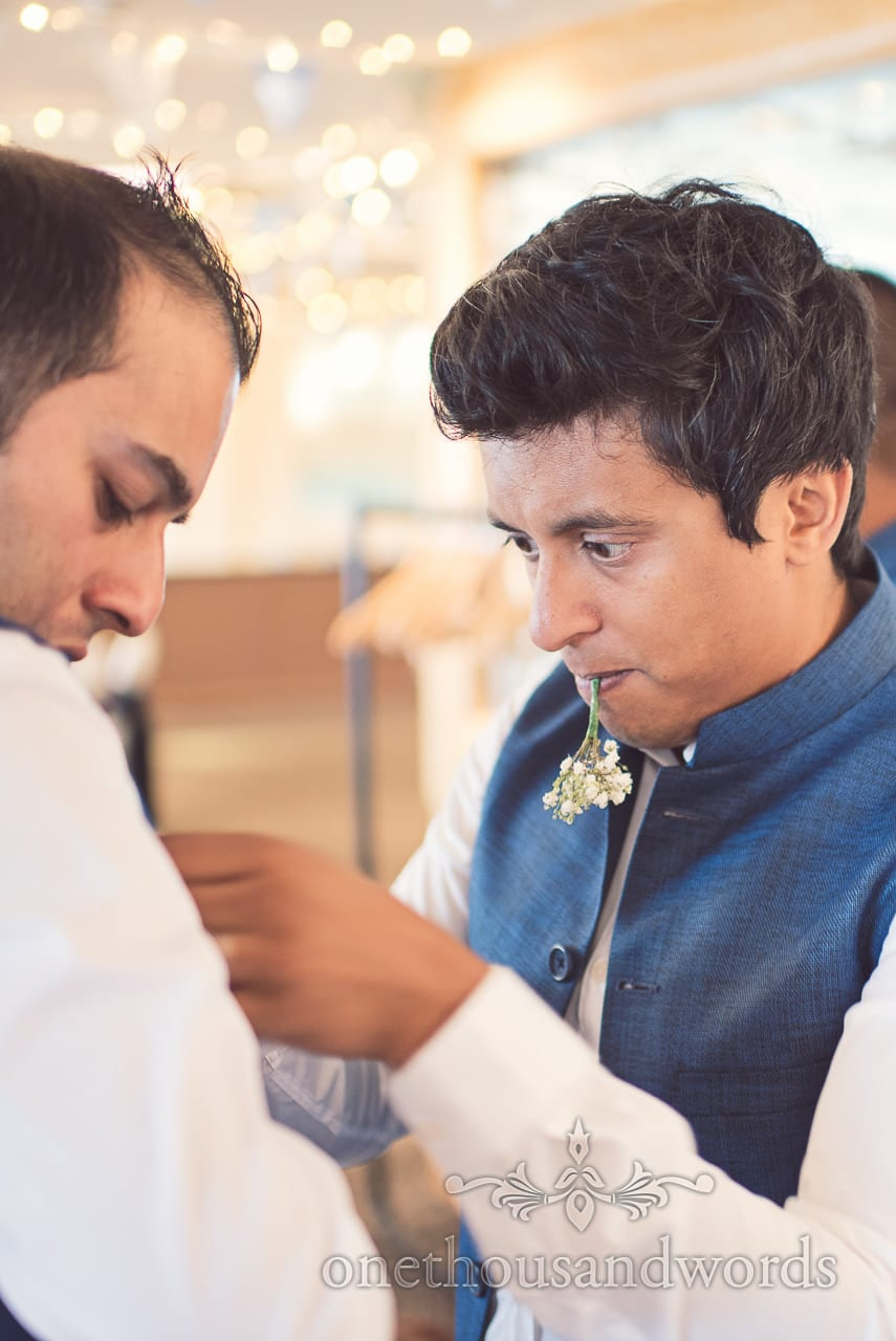 Usher pins wedding button hole at Harbour Heights Hotel Wedding