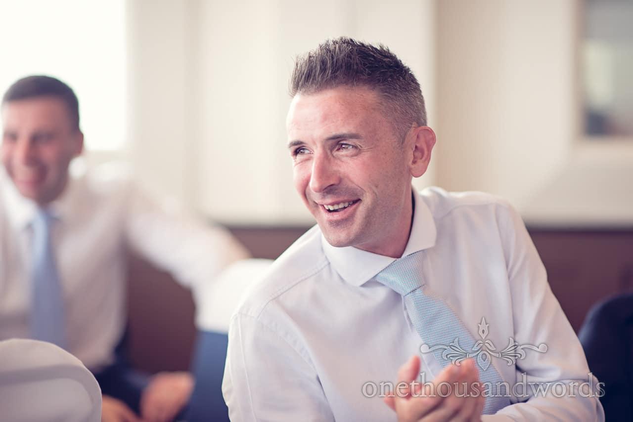Wedding guest applauds wedding speeches at Harbour Heights Hotel Wedding