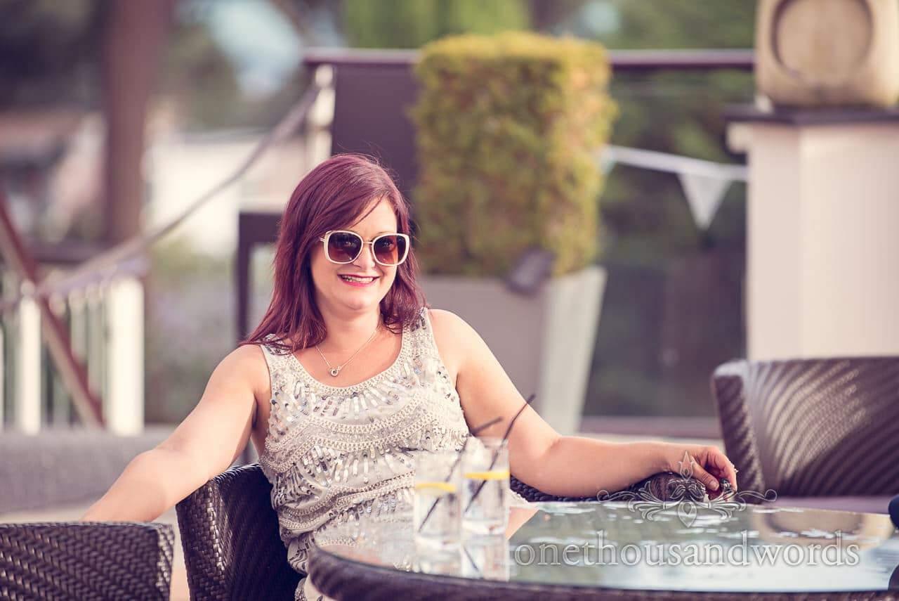 Wedding guest enjoys Harbour Heights Hotel Wedding sun terrace