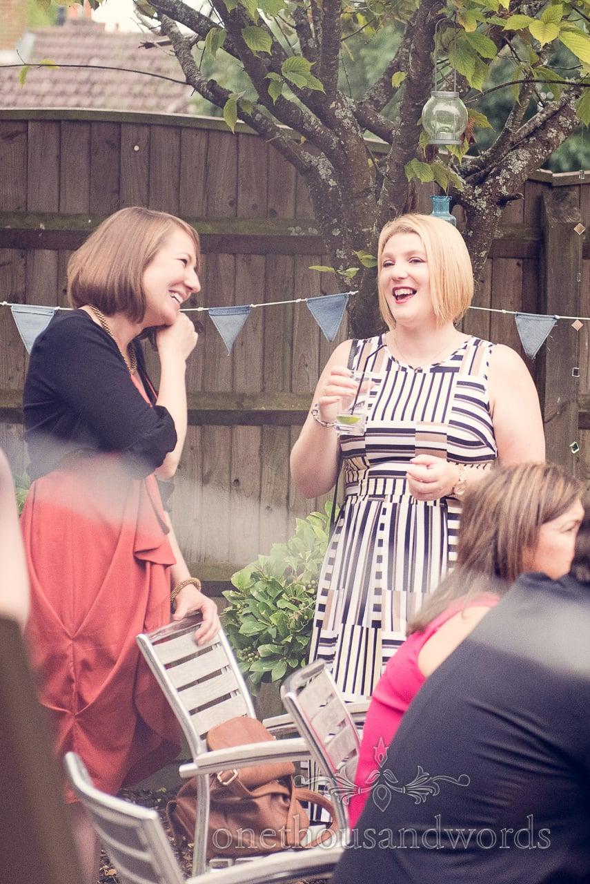 Wedding guests chatting during drinks reception at Balmer Lawn Hotel Wedding
