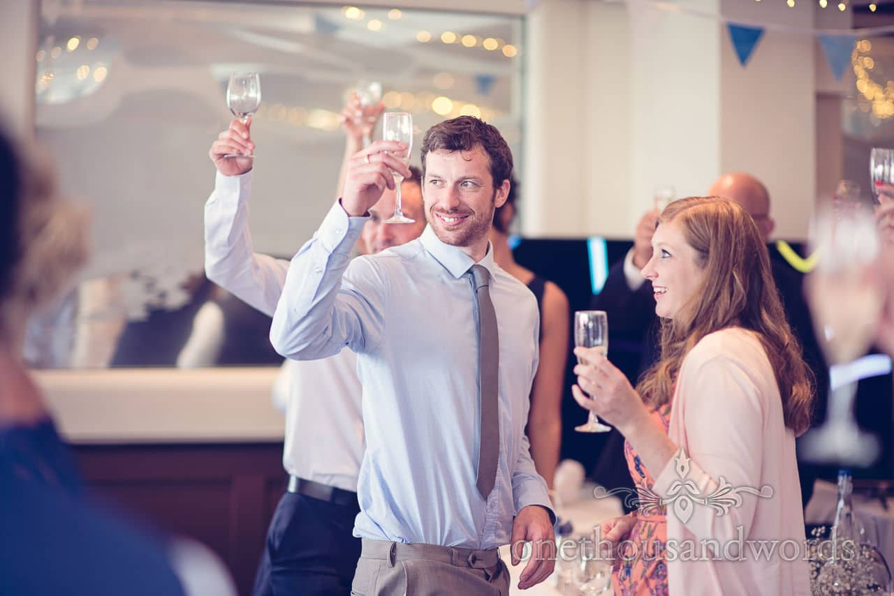 Wedding guests drink wedding toasts at Harbour Heights Hotel Wedding speeches