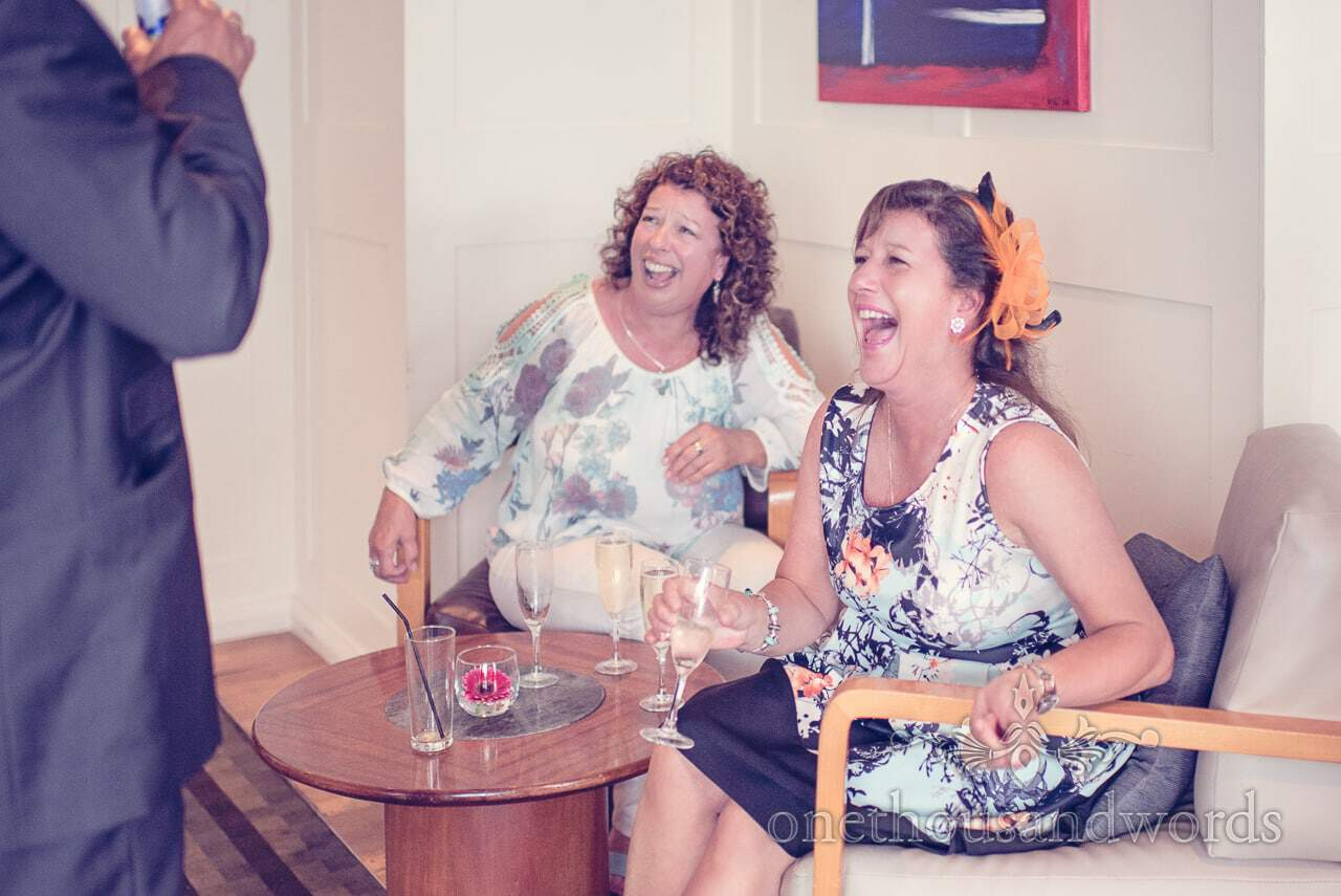 Wedding guests in floral outfits laughing at Harbour Heights Hotel Wedding