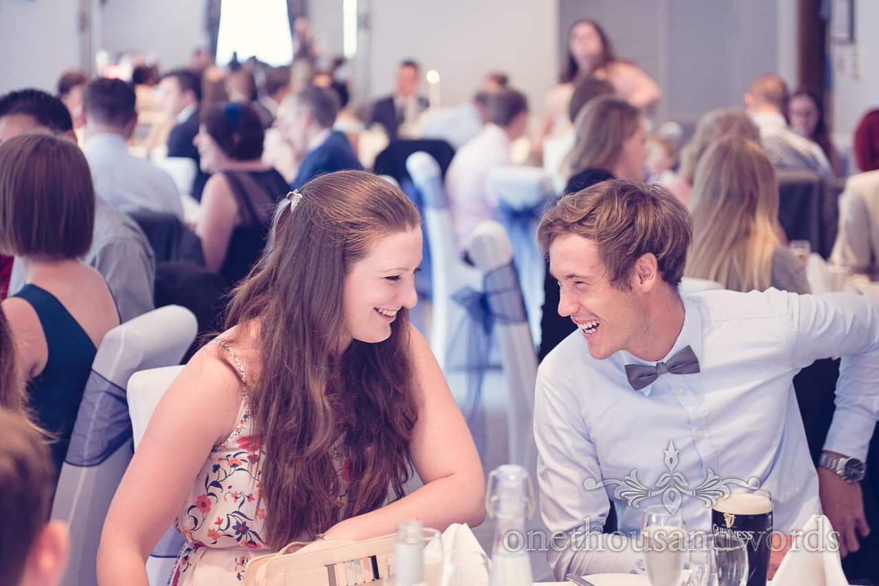 Wedding guests laughing during Balmer Lawn Hotel Wedding breakfast