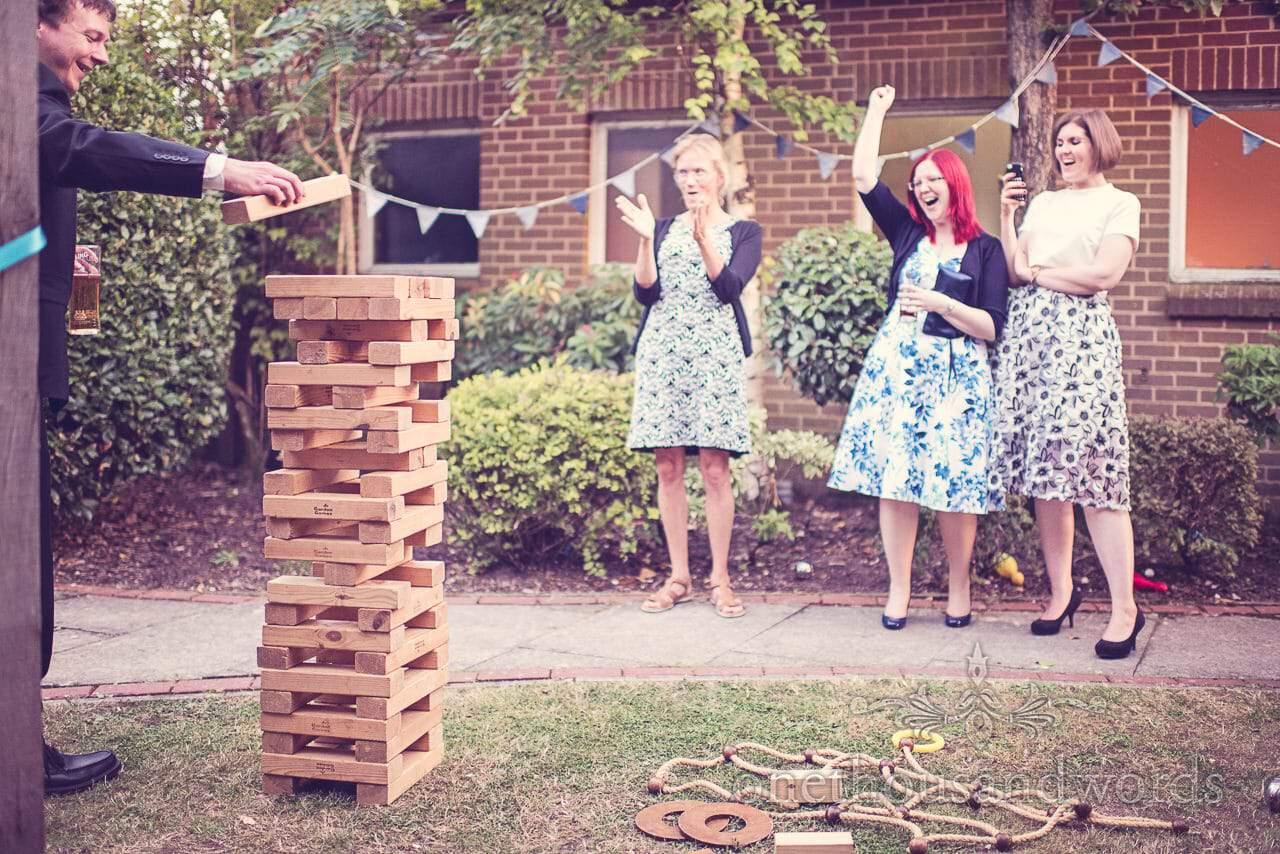 Wedding guests play giant Jenga garden game at Balmer Lawn Hotel Wedding