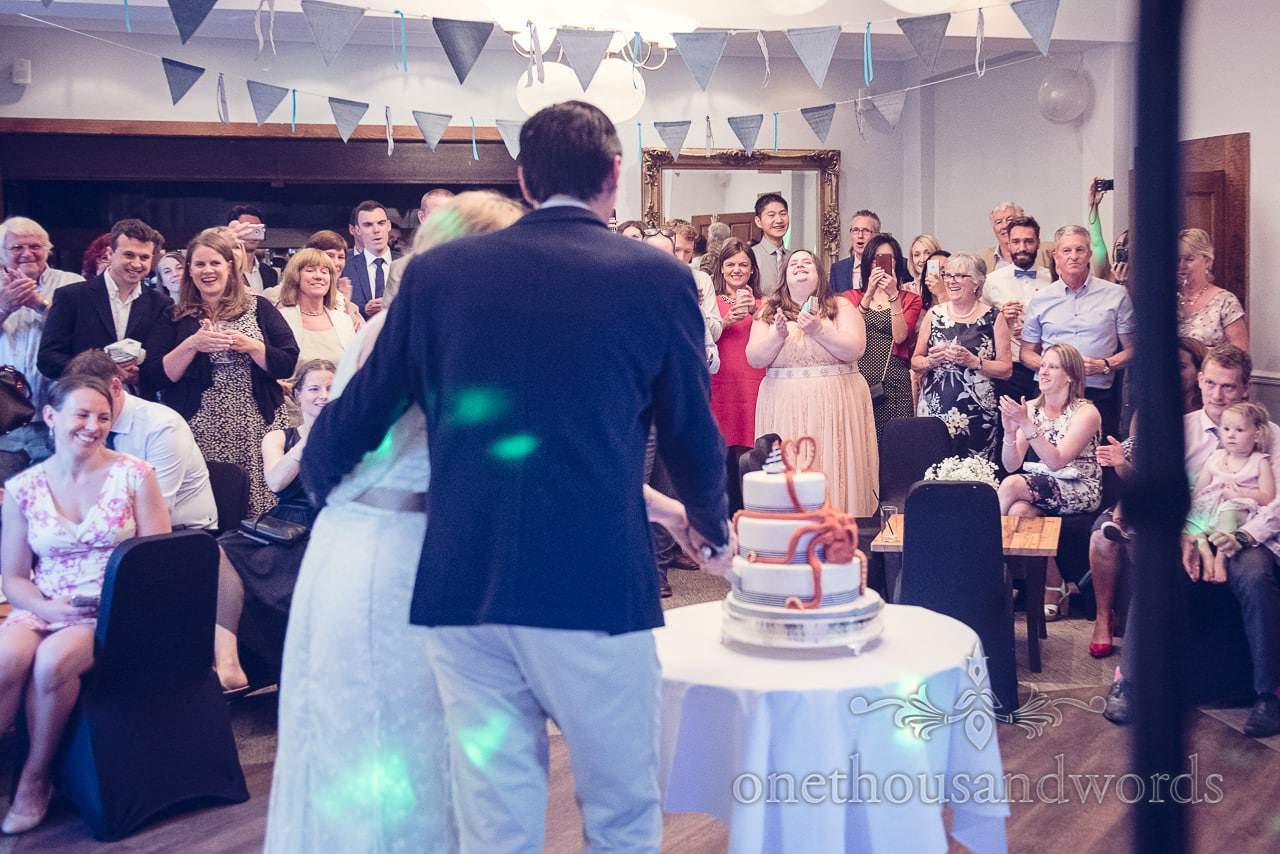 Wedding guests watch cutting of the cake at Balmer Lawn Hotel Wedding