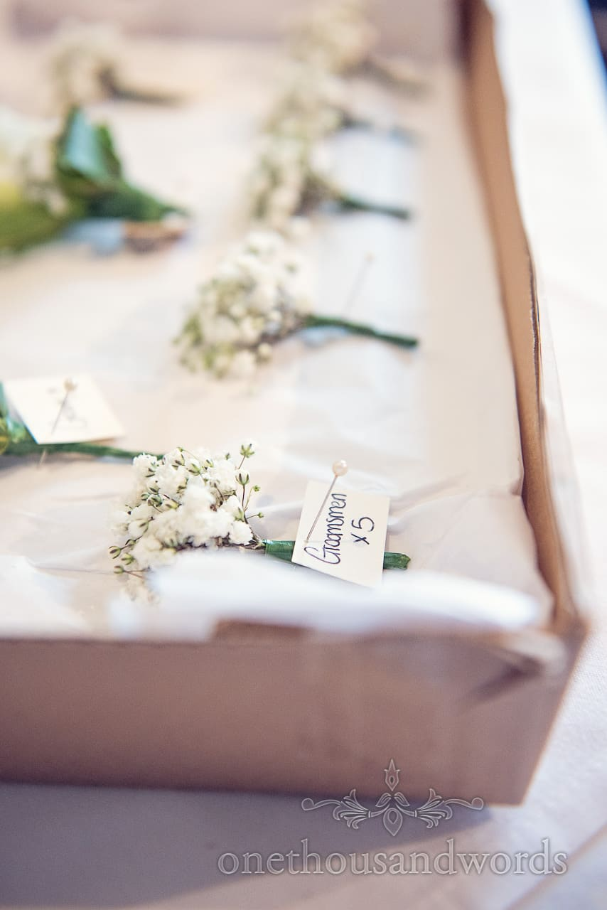 White groomsmen button hole flowers at Harbour Heights Hotel Wedding